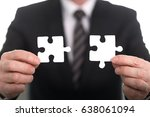 hands joining two puzzle pieces ... | Shutterstock . vector #638061094