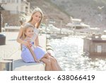 mother and daughter on the sea... | Shutterstock . vector #638066419