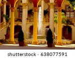 courtyard scene with roman columns and water feature