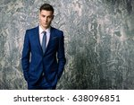 fashion shot of a handsome... | Shutterstock . vector #638096851
