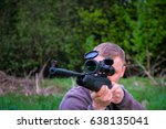 Small photo of man with air gun