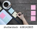 hand writing a sticky note on... | Shutterstock . vector #638142805