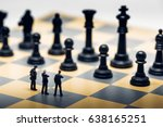 businessmen on a chessboard.... | Shutterstock . vector #638165251