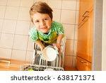 cute boy holding bowls standing ... | Shutterstock . vector #638171371