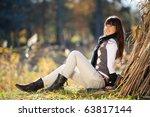 beautiful girl lying near a tree | Shutterstock . vector #63817144