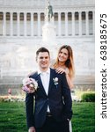Small photo of Bride and groom wedding poses in front of Altar of the Fatherland (Altare della Patria), Rome, Italy