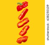 Small photo of Creative concept with flying red capsicum. Sliced floating bell pepper on an orange background. Levity vegetable. Paprika with water drops