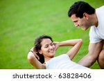 Fit woman and her sports trainer exercising outdoors - stock photo