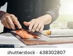 chef cook making sushi outdoor | Shutterstock . vector #638302807