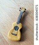 Small photo of small Japanese clay ukulele