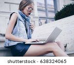 young woman working on laptop.... | Shutterstock . vector #638324065