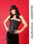 sexy woman wearing a corset and ... | Shutterstock . vector #63834550