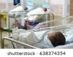 newborn baby  in hospital | Shutterstock . vector #638374354