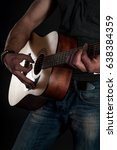 Small photo of Playing guitar. Acoustic guitar in the hands of the guitarist
