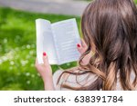 Small photo of Young girl with book in the green garden. Free happy woman. Knowledge is power. Thirst for knowledge. Book in woman hands