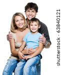 happy young family with pretty... | Shutterstock . vector #63840121