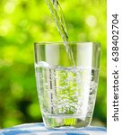 glass of water on nature...   Shutterstock . vector #638402704
