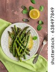 baked asparagus with lemon and... | Shutterstock . vector #638497849