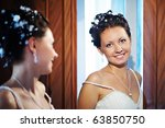 Happy Bride Near Mirror At...