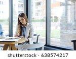 beautiful young woman sitting... | Shutterstock . vector #638574217
