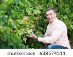 young vintner checking wine...   Shutterstock . vector #638574511