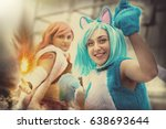 Fantasy world. Disguised cosplay women. Two imaginative characters of the fictional world. A young girl dressed as a cat and another girl with a hand that generates a fire.