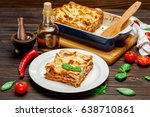 portion of tasty lasagna on... | Shutterstock . vector #638710861