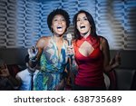 friends singing karaoke in... | Shutterstock . vector #638735689
