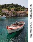 a fishing boat seen moored in... | Shutterstock . vector #638736625