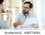 two managers discussing...   Shutterstock . vector #638776081