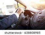 businessman driving car | Shutterstock . vector #638808985