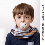 six years old boy with pacifies ... | Shutterstock . vector #638817115