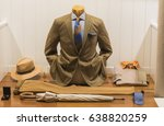 men suit in a store in paris. | Shutterstock . vector #638820259