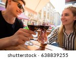 young couple with glasses of... | Shutterstock . vector #638839255