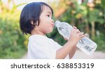 little girl drinking water. | Shutterstock . vector #638853319
