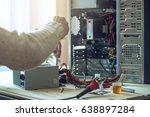 man repairman is trying to fix... | Shutterstock . vector #638897284