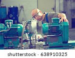 one worker in factory on the... | Shutterstock . vector #638910325