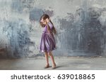 a little girl is spinning at... | Shutterstock . vector #639018865