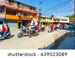 Small photo of Pokhara, Nepal - May 11, 2017: Maoist Communist Party supporters waving flags and riding motorcycles during campaign for the 2017 national elections
