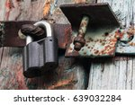 Closed Old Rusty Padlock On A...