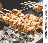 cooking barbecue. pork meat... | Shutterstock . vector #639033715