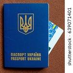 Small photo of Ukrainian passport for travel abroad (abolition of Schengen visas for Ukrainian - concept)