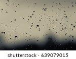 rain drops on window surface... | Shutterstock . vector #639079015