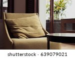 side view of brown sofa is near ... | Shutterstock . vector #639079021