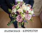the groom is holding a... | Shutterstock . vector #639093709