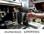 prepare coffee in coffee machine   Shutterstock . vector #639094501