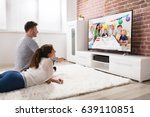 young couple watching party... | Shutterstock . vector #639110851