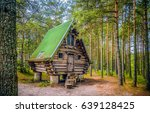 Wooden Hut In Forest Landscape...