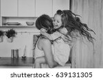 mom and daughter in the kitchen | Shutterstock . vector #639131305