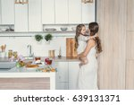 mom and daughter in the kitchen.... | Shutterstock . vector #639131371